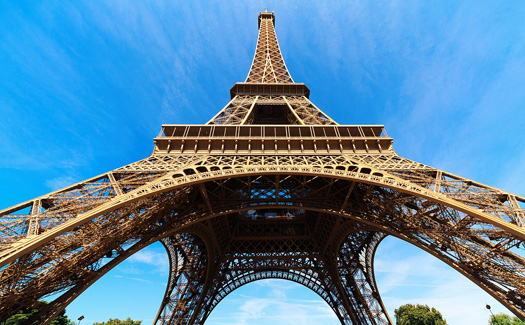 Nithi Anand, Low angle of The Eiffel Tower, via Flickr CC BY 2.0